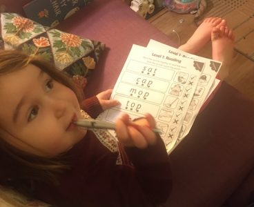 Childing completing phonics activities worksheets